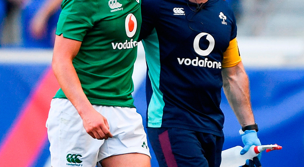 Joey Carbery of Ireland leaves the pitch with an injury