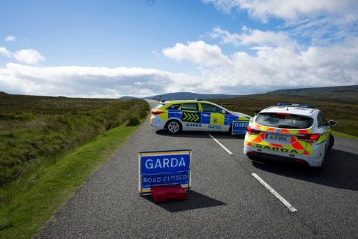 Garda checkpoint on Old Military Rd. in the Dublin Mountains near where remains of a body were found. Photo: Doug O'Connor