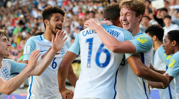 England's Dominic Calvert-Lewin, center, celebrates with his team mates after scoring a goal against Venezuela