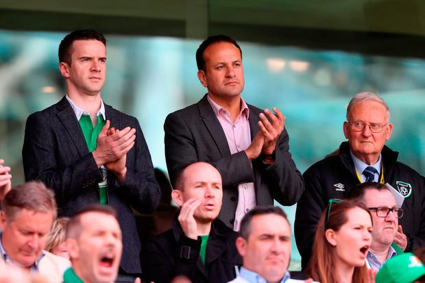 Leader of Fine Gael Leo Varadkar (right) and partner Matt Barrett (left) in the stands during the 2018 FIFA World Cup Qualifying, Group D match at the Aviva Stadium, Dublin. Credit: Niall Carson/PA Wire