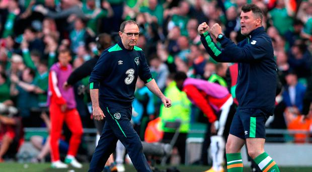 Republic of Ireland manager Martin O'Neill (left) and Assistant manager Roy Keane celebrates their side's first goal of the game during the 2018 FIFA World Cup Qualifying, Group D match at the Aviva Stadium, Dublin. PRESS ASSOCIATION Photo: Brian Lawless/PA Wire.
