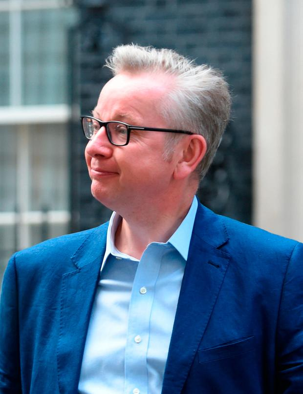 Michael Gove, who has been appointed Environment Secretary, leaves 10 Downing Street in London Credit: David Mirzoeff/PA Wire