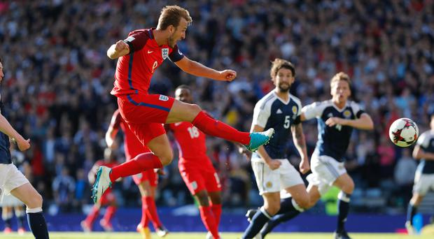 Harry Kane scores England's last-gasp equaliser against Scotland but their new captain's goals failed to mask the team's shortcomings. Photo: Reuters