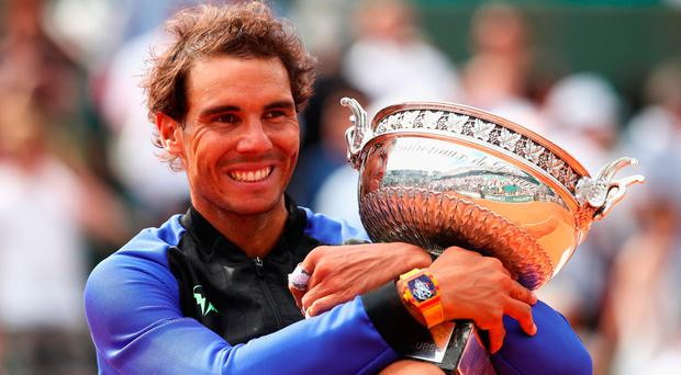 Rafael Nadal has a firm grip on the trophy as he celebrates after beating Stan Wawrinka at Roland Garros to win the French Open for the 10th time. Photo by Julian Finney/Getty Images