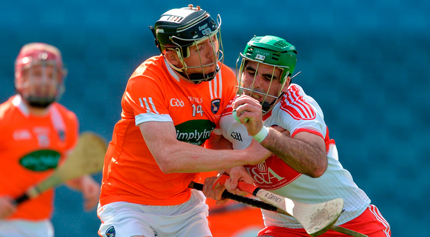 Derry's Seán Cassidy clashes with Armagh's Ryan Gaffney. Photo by Piaras Ó Mídheach/Sportsfile