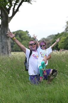 Runners take part in the Colour Dash, including Phil Orr, left, and his daughter Kirsty (5). Photo: Collins Photos