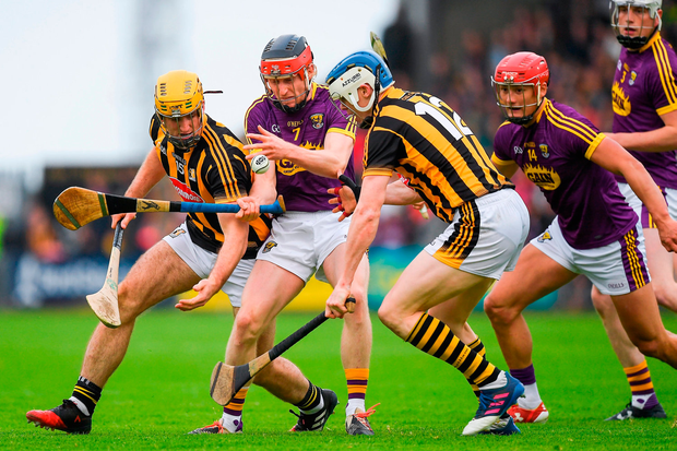 Diarmuid O'Keeffe of Wexford in action against Colin Fennelly, left, and T.J. Reid of Kilkenny. Photo by Ray McManus/Sportsfile