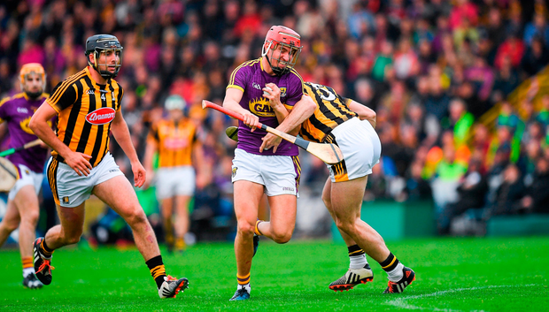 Paul Morris of Wexford in action against Conor Fogarty and Conor O'Shea of Kilkenny, left. Photo by Ray McManus/Sportsfile