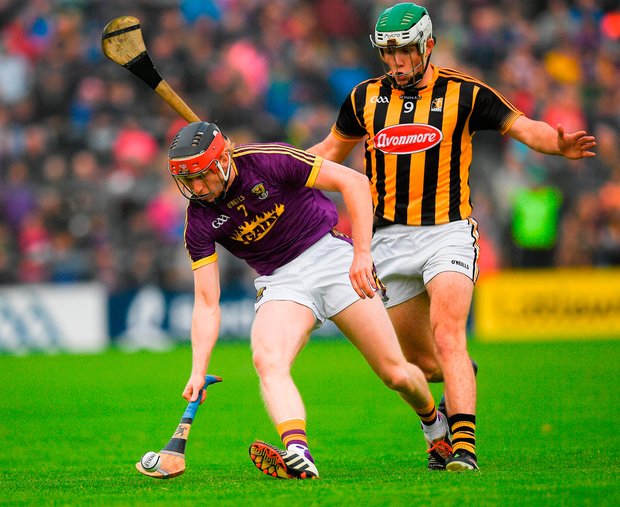 Diarmuid O'Keeffe of Wexford in action against Paddy Deegan of Kilkenny. Photo by Ray McManus/Sportsfile