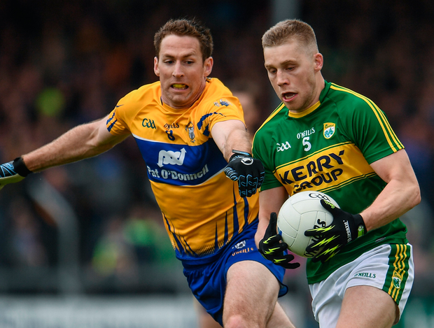 Kerry's Peter Crowley keeps possession against Clare's Gary Brennan. Photo: Sportsfile