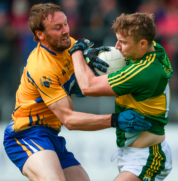 Kerry's James O'Donoghue is challenged by Clare's Ciaran Russell. Photo: Sportsfile