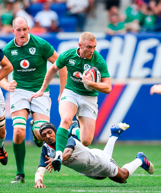 Keith Earls of Ireland is tackled by Marcel Brache of USA. Photo by Ramsey Cardy/Sportsfile