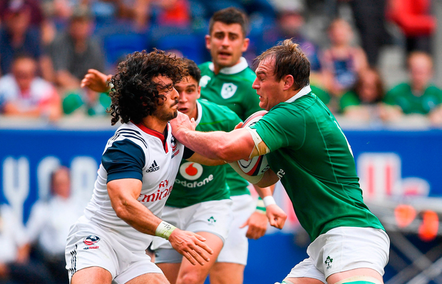 Rhys Ruddock of Ireland is tackled by Ryan Matyas of USA. Photo by Ramsey Cardy/Sportsfile