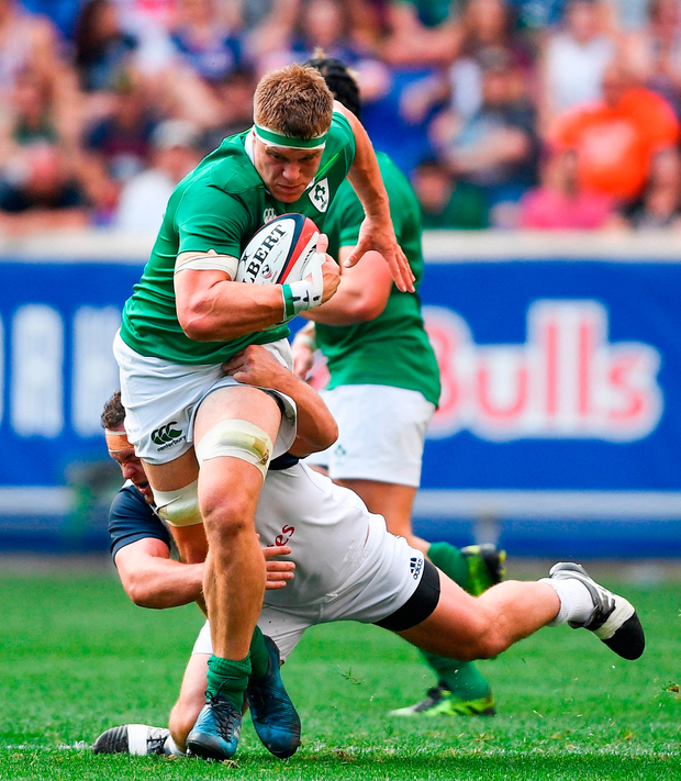 Josh van der Flier of Ireland is tackled by Ben Tarr of USA. Photo by Ramsey Cardy/Sportsfile