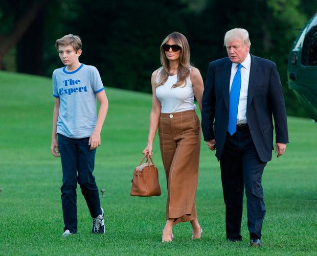 U.S. President Donald Trump, first lady Melania Trump and their son Barron Trump arrive at the White House June 11, 2017 in Washington, DC. According to reports, Melania and Barron will soon be moving from Trump Tower in New York City to the White House. (Photo by Chris Kleponis-Pool/Getty Images)