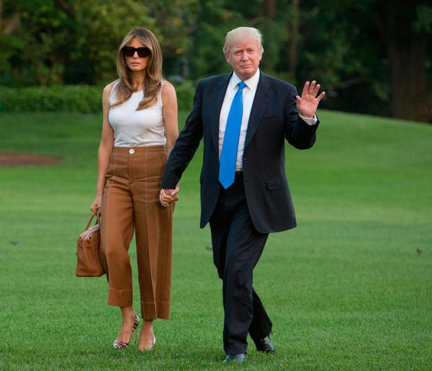U.S. President Donald Trump and first lady Melania Trump arrive at the White House June 11, 2017 in Washington, DC. According to reports, Melania and Barron will soon be moving from Trump Tower in New York City to the White House. (Photo by Chris Kleponis-Pool/Getty Images)