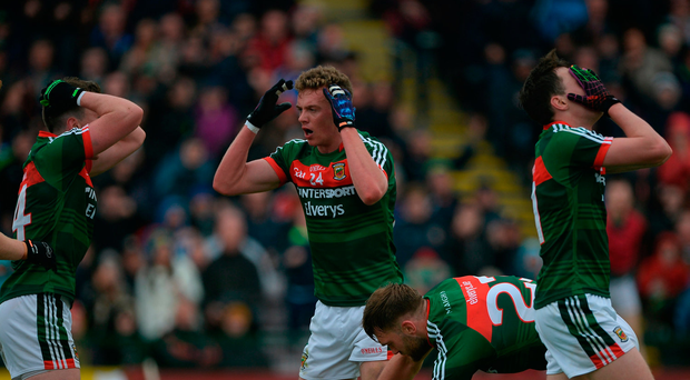 Mayo players, left to right, Cillian O'Connor, Danny Kirby, and Diarmuid O'Connor react to conceding a free late in the game