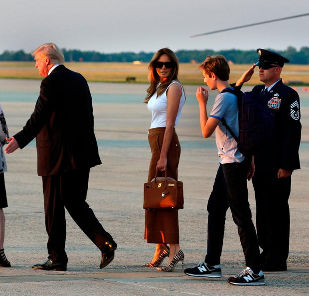 U.S. President Donald Trump with First Lady Melania Trump and their son Barron arrive at Joint Base Andrews outside Washington, U.S., after a weekend at Trump National Golf Club in Bedminster, New Jersey, U.S., June 11, 2017. REUTERS/Yuri Gripas