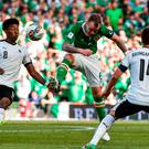 Glenn Whelan of Republic of Ireland in action against David Alaba, left, and Julian Baumgartlinger of Austria yesterday