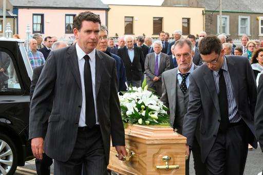 Funeral of Austin Deacy at St.Mary's parish church Dungarvan. John Deacy TD and his brother Jamie lead their father's coffin into the church.Photo;Mary Browne