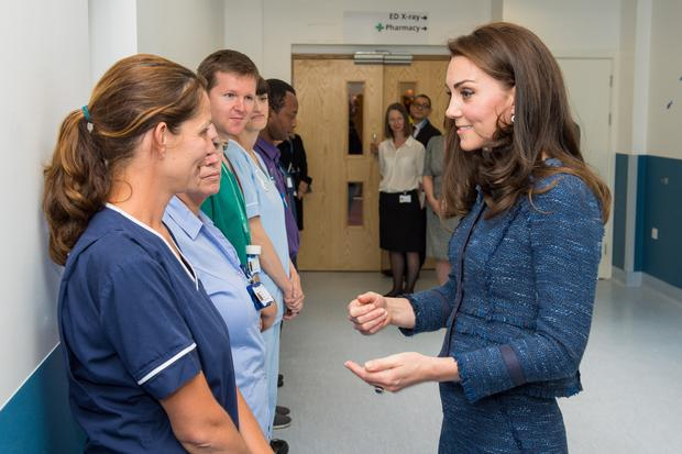 The Duchess of Cambridge speaks to Team Leader Ellen (left, surname not given) during a visit to Kings College Hospital in south London where she met staff and patients who were affected by the terrorist attacks in London Bridge and Borough Market, on June 12, 2017 in London, England. (Photo by Dominic Lipinski - WPA Pool / Getty Images)