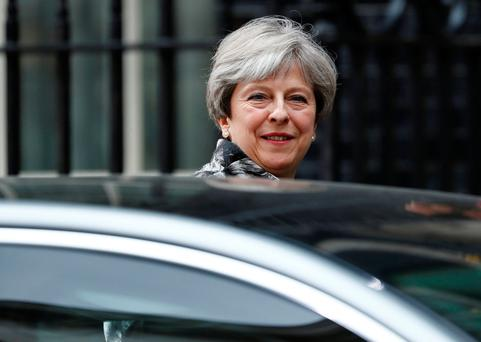 British Prime Minister Theresa May leaves Downing Street. Photo: Reuters