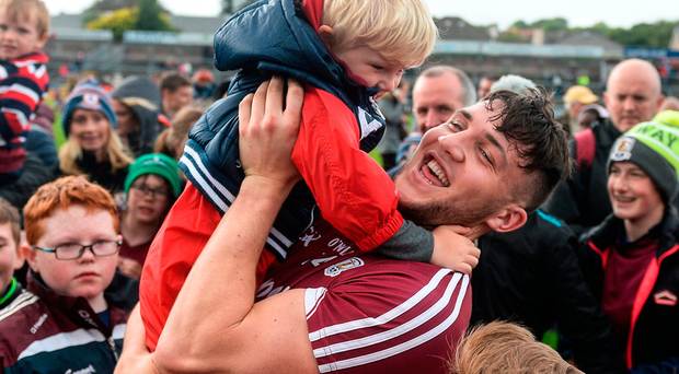 Damien Comer of Galway celebrates with Rian Sheridan, aged 4, from Athenry, Co Galway after the Connacht GAA Football Senior Championship Semi-Final match between Galway and Mayo at Pearse Stadium, in Salthill, Galway. Photo: Sportsfile