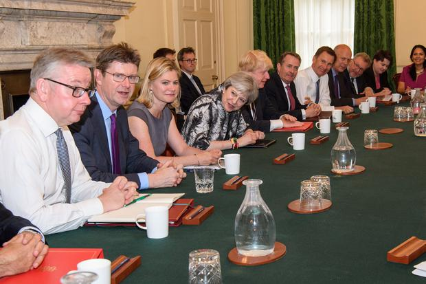 Britain's Prime Minister Theresa May holds the first cabinet meeting following the general election at No 10 Downing Street in London. Photo: Leon Neal
