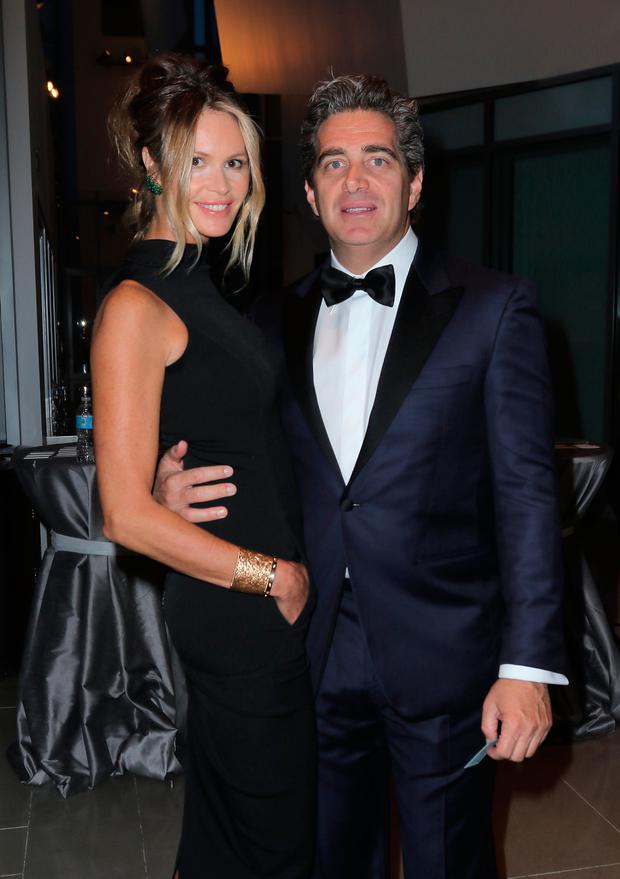 Elle MacPherson (L) and Jeffrey Soffer during Pritzker Architecture Prize 2015 at New World Symphony on May 15, 2015 in Miami Beach, Florida. (Photo by John Parra/Getty Images for Pritzker Architecture Prize)