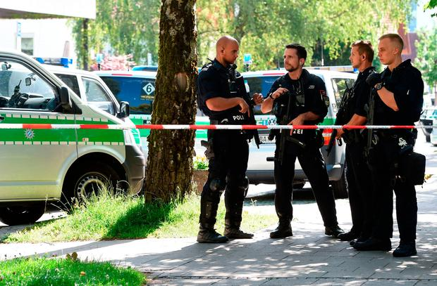 Police officers secure the area around a commuter rail station in Unterfoehring near Munich, southern Germany, where shots were fired on June 13, 2017. According to the police, several people were injured by the shots and a female police officer was badly wounded. Picture: AFP PHOTO / Christof STACHECHRISTOF STACHE/AFP/Getty Images