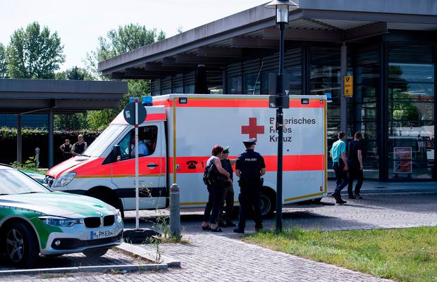 An ambulance stands near a subway station in Munich, Germany (Sven Hoppe/dpa via AP)