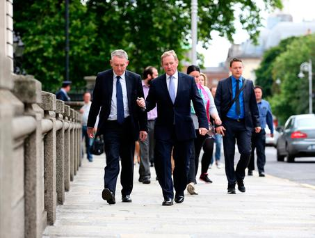 His Last Day......Taoiseach Enda Kenny,TD accompanied by his garda escort Det.Garda Frank White arriving for his last Cabinet meeting at Government Buildings this morning (Pic Tom Burke)