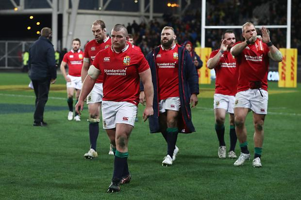 DUNEDIN, NEW ZEALAND - JUNE 13: Dejected Lions players walk off the pitch following their 23-22 defeat during the 2017 British & Irish Lions tour match between the Highlanders and the British & Irish Lions at the Forsyth Barr Stadium on June 13, 2017 in Dunedin, New Zealand. (Photo by David Rogers/Getty Images)