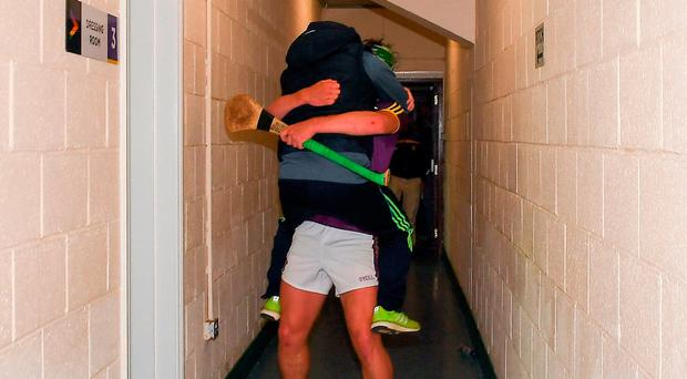 The suspended Wexford manager Davy Fitzgerald celebrates with Conor McDonald in the tunnel after the Leinster GAA Hurling Senior Championship Semi-Final match between Wexford and Kilkenny at Wexford Park in Wexford. Photo by Ray McManus/Sportsfile