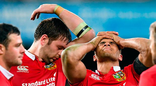 British and Irish Lions players Iain Henderson and team mate Jonathan Joseph react after losing to the Otago Highlanders