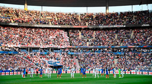 England and French players stand during a minute's silence ahead of the international friendly football match between France and England at The Stade de France Stadium in Saint-Denis near Paris