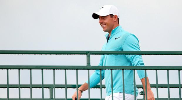 Rory McIlroy walks across the players bridge to the range to warm up before a practice round of the U.S. Open golf tournament at Erin Hills. Credit: Rob Schumacher-USA TODAY Sports