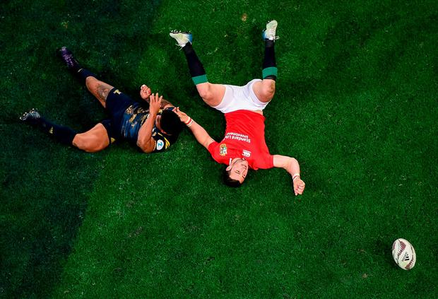 Robbie Henshaw is left on his back after a tackle from Malakai Fekitoa. Photo: Stephen McCarthy/Sportsfile