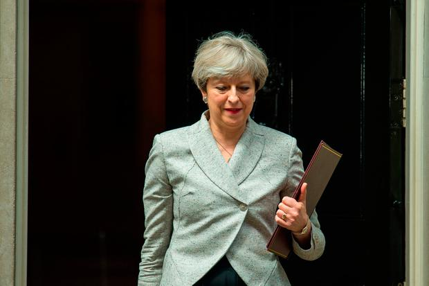 Theresa May leaving 10 Downing Street in London during talks with DUP leader Arlene Foster and DUP deputy leader Nigel Dodds on a deal to prop up a Tory minority administration. Photo: PA