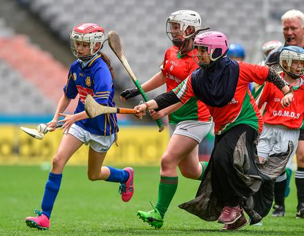 Kate O'Connor of Scoil Bhride GNS, Palmerstown, is tackled by Marya Shalabi of Griffith Barracks Multi-Denominational School, Dublin, during the Allianz Cumann na mBunscol Finals at Croke Park in Dublin. Photo: David Maher, Sportsfile
