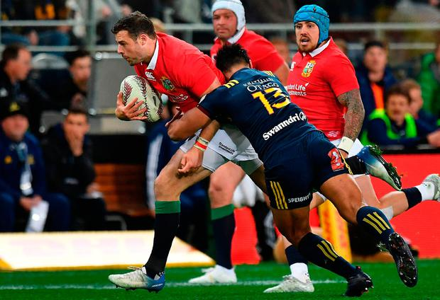 British and Irish Lions' Robbie Henshaw (l) is tackled by Otago Highlanders' Malakai Fekitoa during their match at Forsyth Barr Stadium in Dunedin yesterday. Photo: Getty Images