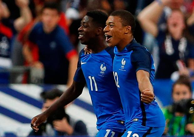 France's Ousmane Dembele celebrates scoring their third goal with Kylian Mbappe. Photo: Reuters / Lee Smith