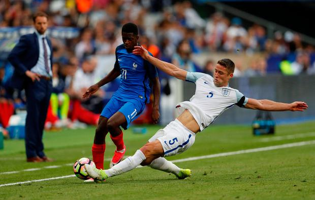 France's Ousmane Dembele in action with England's Gary Cahill. Photo: Reuters / Lee Smith