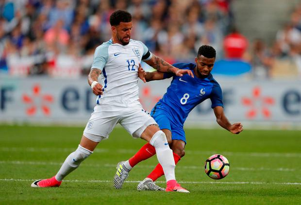 England's Kyle Walker in action with France's Thomas Lemar. Photo: Reuters / Charles Platiau