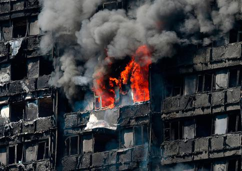 Smoke billows from a fire that has engulfed the 24-storey Grenfell Tower in west London. PRESS ASSOCIATION Photo. Picture date: Wednesday June 14, 2017. More than 200 firefighters were sent to tackle the blaze and London Ambulance Service said 30 people had been taken to five hospitals. See PA story FIRE Grenfell. Photo credit should read: Jonathan Brady/PA Wire