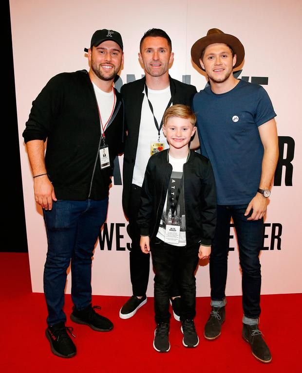 Robbie Keane and son Robert backstage at the One Love Manchester concert with Scooter Braun (left) and Niall Horan.