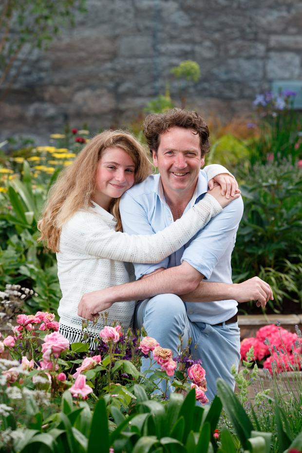 Diarmuid Gavin with his daughter Eppie at the garden he designed in Dundrum Town Centre. Photograph: ©Fran Veale