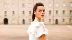 White layered split top with ruffle detail, €495.00 and embroidered daisy organza pleated skirt. €550.00.