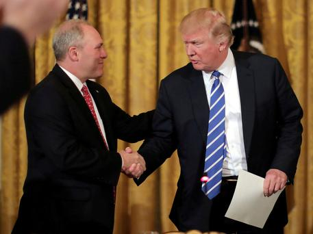 U.S. President Donald Trump shakes hands with House Majority Whip Steve Scalise