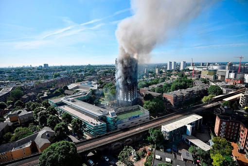 Smoke rises after a fire engulfed Grenfell Tower. Photo: GETTY